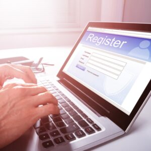 hands typing on laptop to register